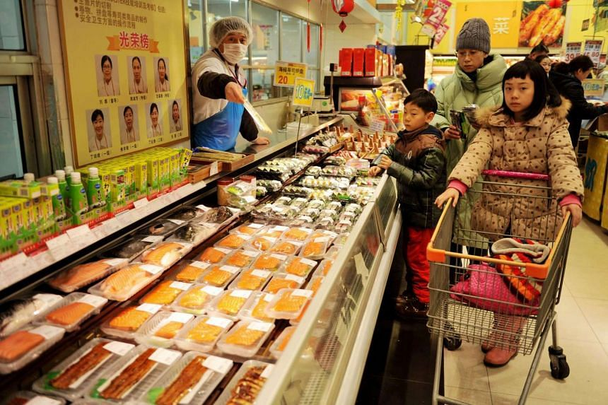 Chinese customers buying food at a supermarket in Qingdao, east China's Shandong province,  n Feb 14, 2017.
