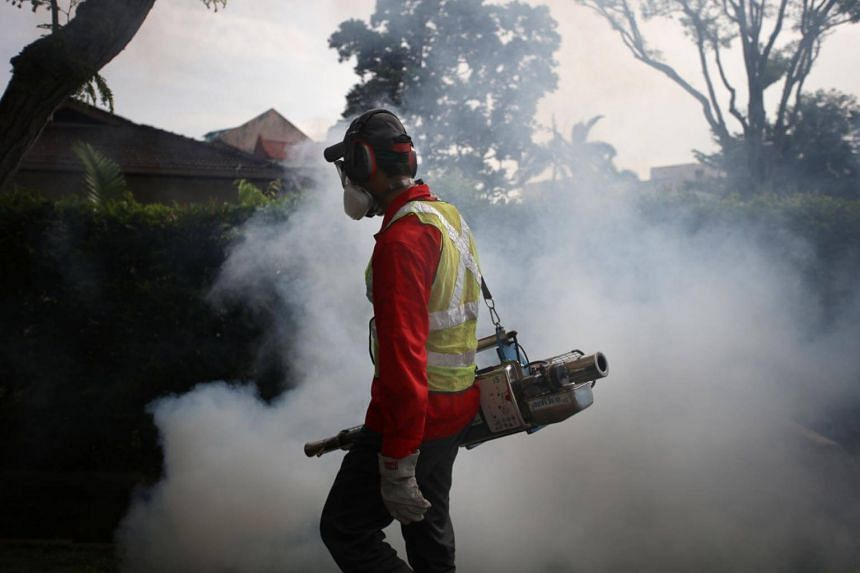 NEA officers and Pest Control Operators fumigating the vicinity of Simon Place after a case of Zika was reported, on March 30, 2017.