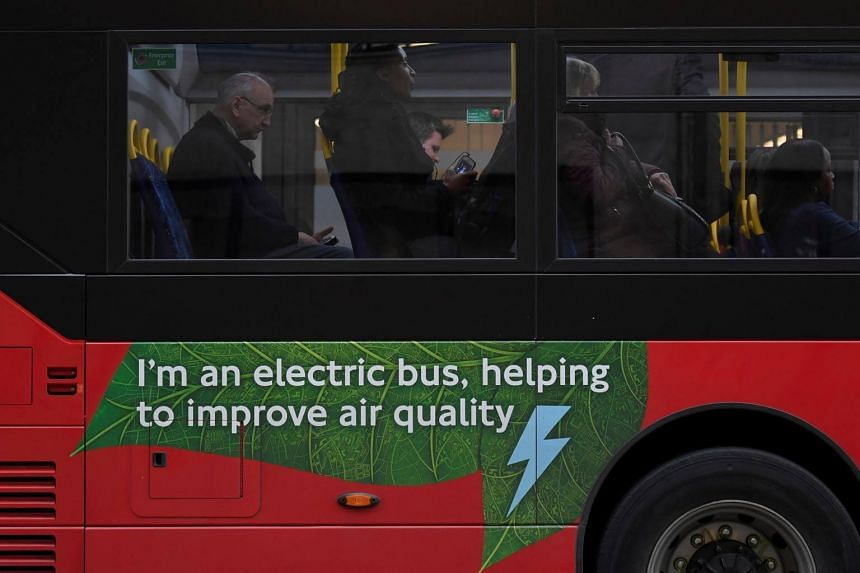Passengers sit on an electric public bus on the day that Mayor of London, Sadiq Khan, outlined plans to place a levy on the most polluting vehicles in London, Britain, on April 4, 2017.