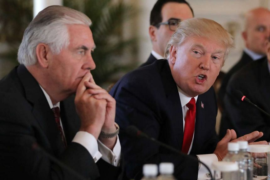 US President Donald Trump (right) speaks next to Secretary of State Rex Tillerson during a bilateral meeting with China's President Xi Jinping (not pictured) at Trump's Mar-a-Lago estate in Palm Beach, Florida, on April 7, 2017.