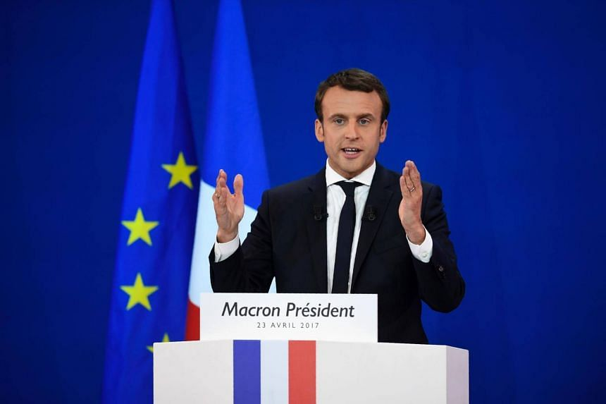 French presidential election candidate for the En Marche ! movement Emmanuel Macron delivers a speech after the first round of the Presidential election at the Parc des Expositions in Paris, on April 23, 2017.