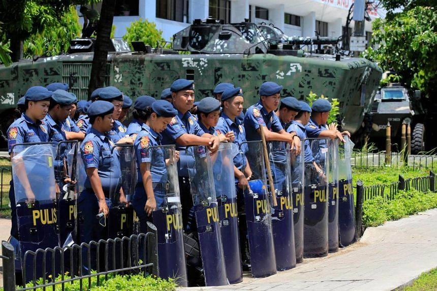 Members of the Philippine National Police stand guard with their shields for possible protest rallies near the venue of the coming Association of South East Asian Nation summit in Pasay City, Manila, Philippines on April 24, 2017.
