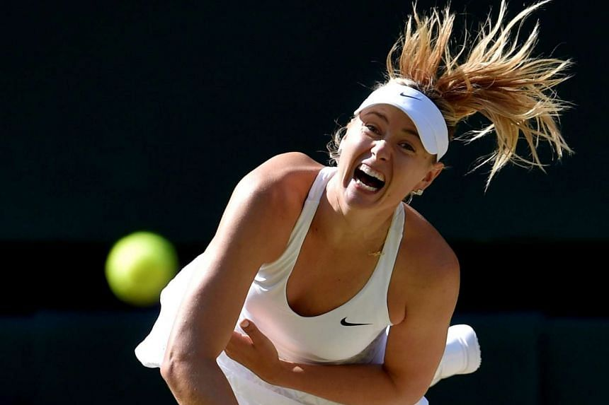 Maria Sharapova of Russia serving during her match against Serena Williams of the US at the Wimbledon Tennis Championships, on July 9, 2015.