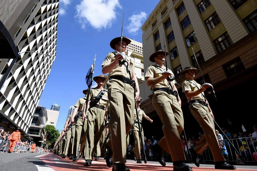 Defence forces veterans and active servicemen and women take part in an Anzac Day march through central Brisbane, Queensland, Australia, on April 25, 2017.