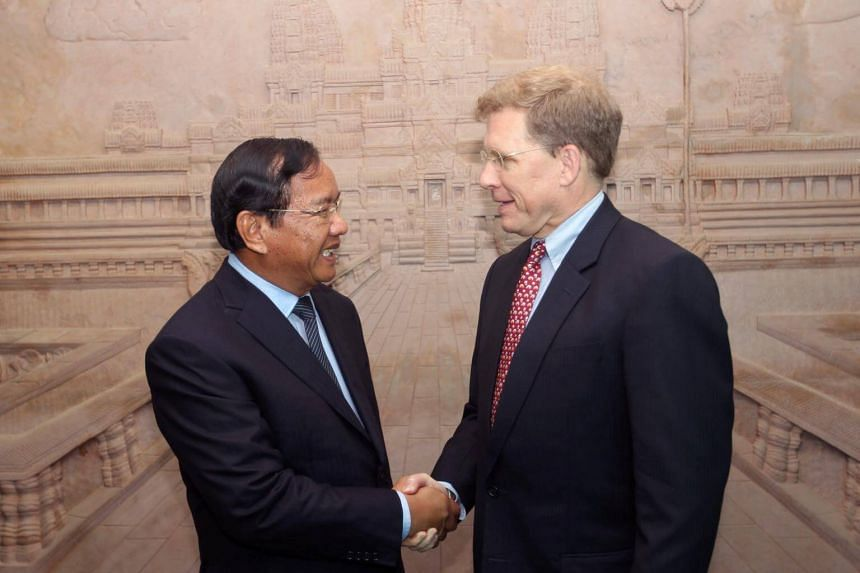 US Deputy Assistant Secretary of State for Southeast Asia Patrick Murphy (right) shakes hands with Cambodian Foreign Minister Prak Sokhon before a meeting at the Ministry of Foreign Affairs and International Cooperation in Phnom Penh, Cambodia on Apr