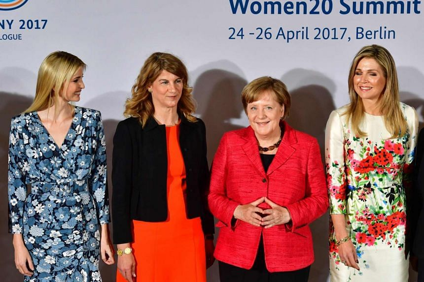 (From left to right) First Daughter and Advisor to the US President Ivanka Trump, co-chairwoman of the W20 Stephanie Bschorr, German Chancellor Angela Merkel and Queen Maxima of the Netherlands pose for a family photo during the W20 women's empowerme