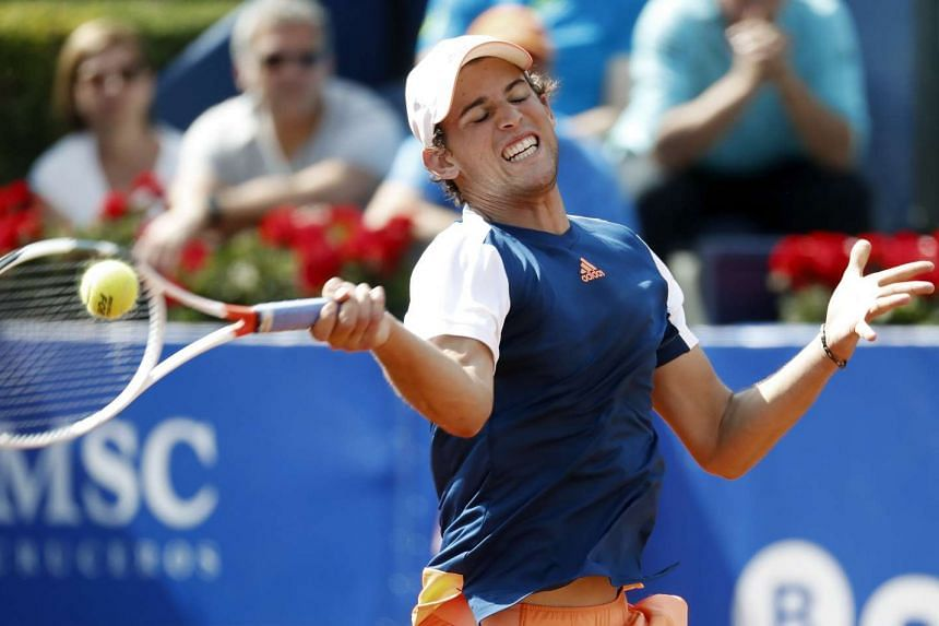 Dominic Thiem of Austria hits the ball against Kyle Edmund of Britain during their first round match of the Barcelona Open.