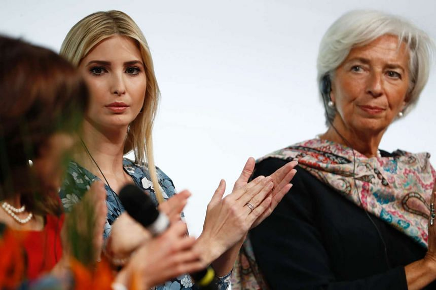First daughter and advisor to the US President, Ivanka Trump, and the managing director of the International Monetary Fund Christine Lagarde, applaud at the start of a panel discussion at the W20 women's empowerment summit on April 25, 2017 in Berlin