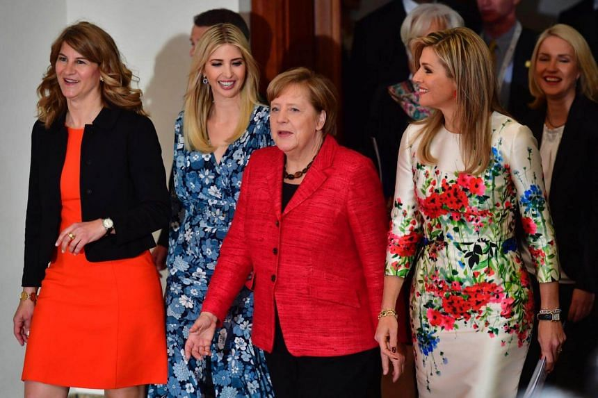 (From left) co-chairwoman of the W20 Stephanie Bschorr, First Daughter and Advisor to the US President Ivanka Trump, German Chancellor Angela Merkel, Queen Maxima of the Netherlands and German Family Minister Manuela Schwesig arrive to pose for a fam