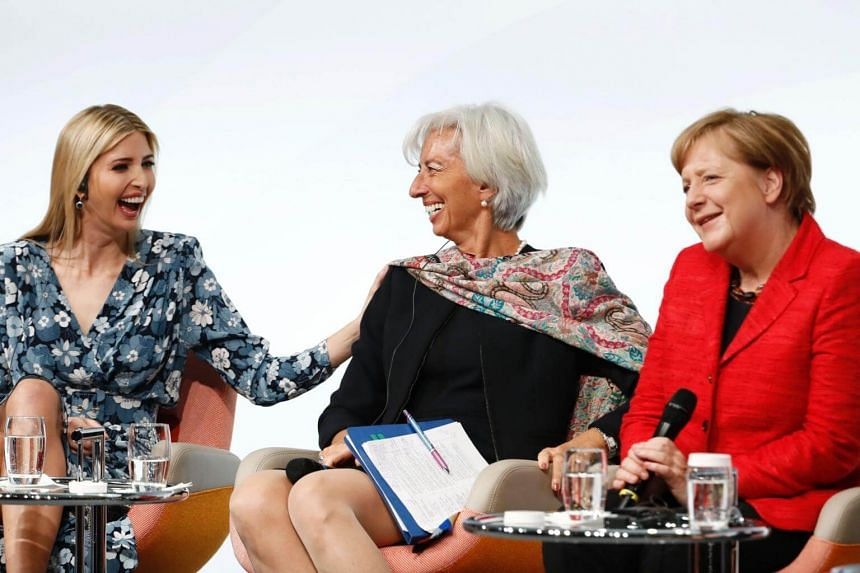 US President's daughter Ivanka Trump, International Monetary Fund's managing director Christine Lagarde and German Chancellor Angela Merke share a laugh at the start of a panel discussion at the W20 women's empowerment summit on April 25, 2017 in Ber