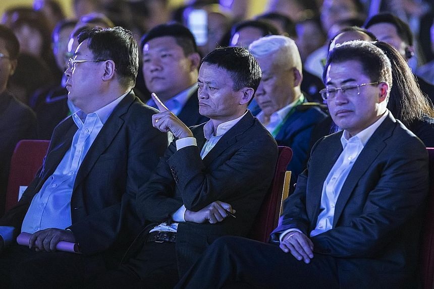 Mr Jack Ma (centre) at the China Green Companies Summit in Zhengzhou on Sunday. He said the world must establish how to work with robots, adding that machines should only do what humans cannot.