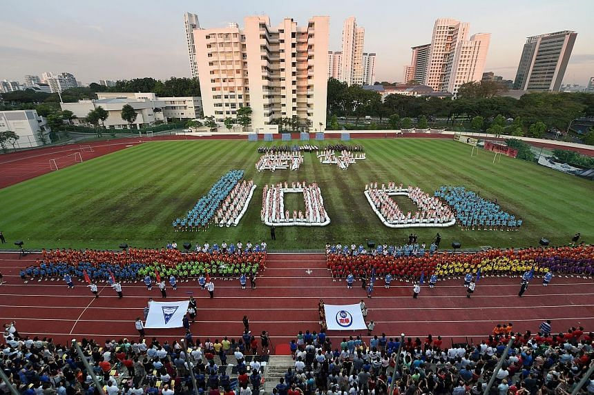 Left: A reunion for Nan Hua Primary School and Nan Hua High School was held last Friday at the NUS High School of Mathematics and Science, the schools' first site in Clementi. Above: More than 1,400 students from both schools put on performances to m