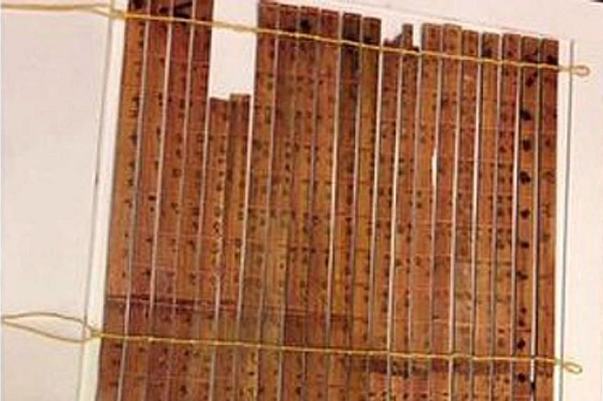 The 21 bamboo slips were crafted around 305BC. When arranged together as a multiplication table, they can do multiplication and division of any two whole numbers under 100 and numbers containing the fraction 0.5.