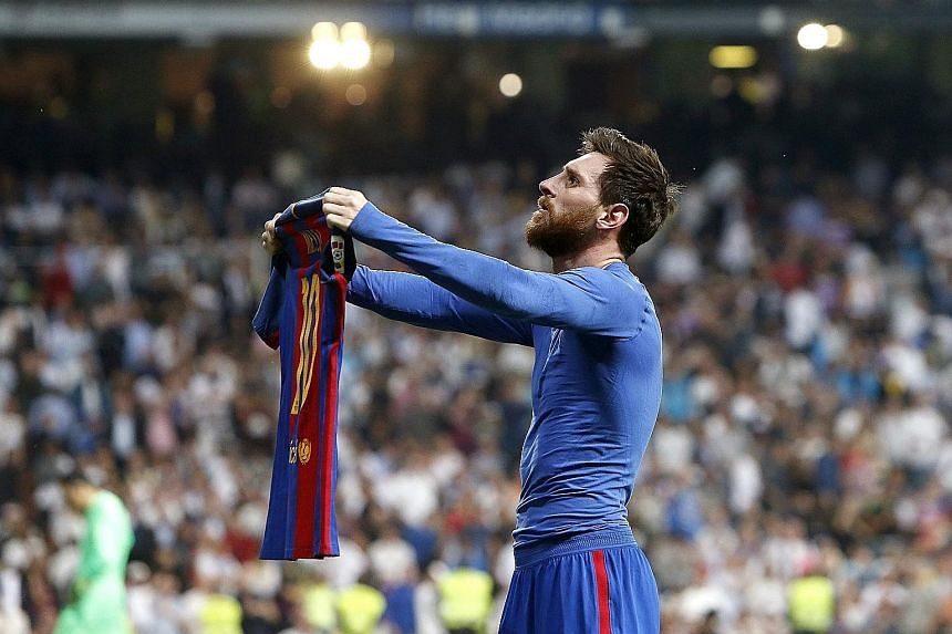Barcelona talisman Lionel Messi posing with his jersey and silencing the baying Real Madrid fans with his 92nd-minute winner at the Santiago Bernabeu.
