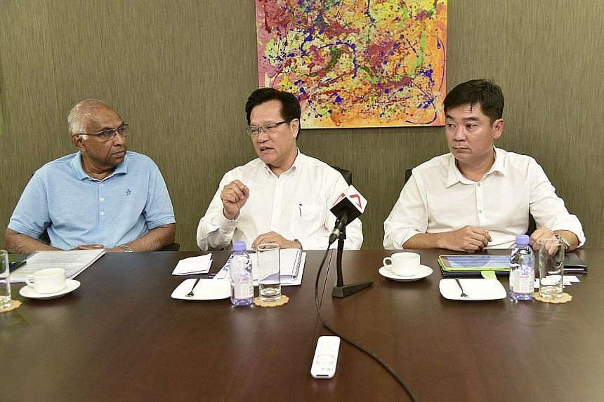 (From left) S. Thavaneson, Lim Kia Tong and Bernard Tan at a media briefing at Komoco Motors yesterday. If elected, they want to ensure that clubs with jackpot operations pump some of the profits back into the local game.