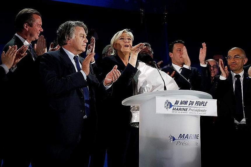 Ms Marine Le Pen celebrating the early results of the first-round vote in Henin-Beaumont on Sunday. The French establishment is rallying around her centrist opponent.