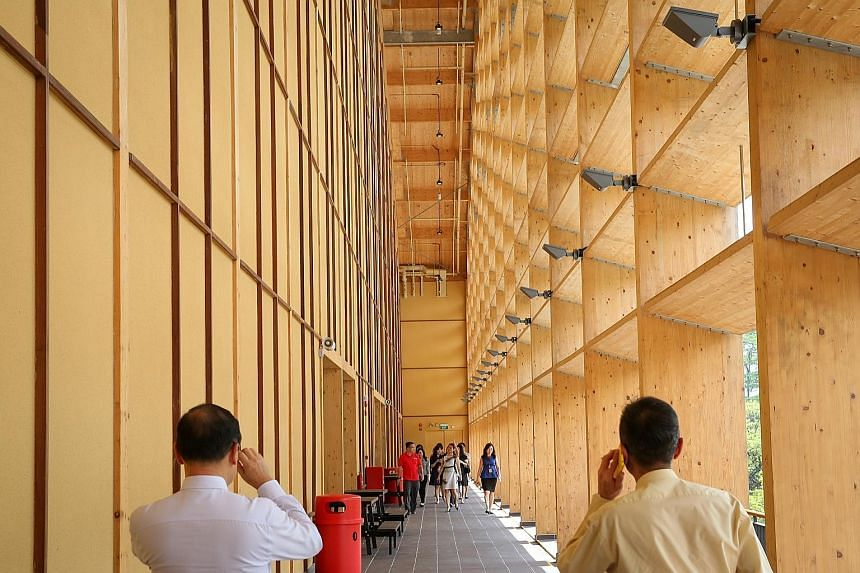 Nanyang Technological University's new sports hall, The Wave, is made mostly of mass engineered timber. Parts are prefabricated, speeding up construction.