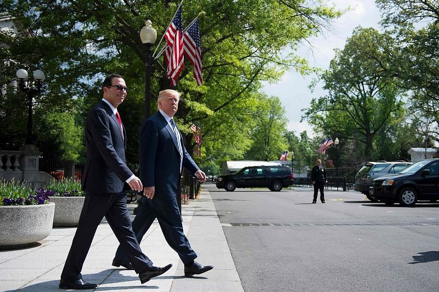 US President Donald Trump with Treasury Secretary Steven Mnuchin outside the White House last Friday. Mr Trump is scrambling to show progress on two leading priorities - healthcare reform and tax cuts.