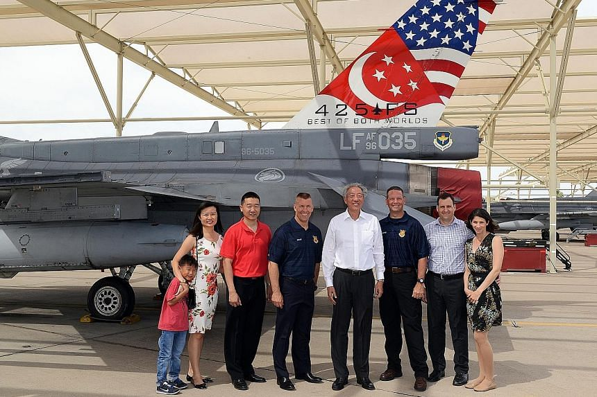 DPM Teo Chee Hean with Lt-Col Kenneth Lim (in red shirt) and his family, and (from left) Brig-Gen Brook Leonard, 56th Fighter Wing Command Chief Master Sergeant Randy Kwiatkowski, and Peace Carvin II US Air Force detachment commander Lt-Col Jason Coo