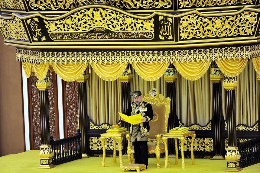 Kelantan's Sultan Muhammad V, seen here reading the Oath of Installation, was officially installed as the 15th Malaysian king yesterday under the country's unique royal rotation involving the nine Malay ruling houses. The installation ceremony, steep
