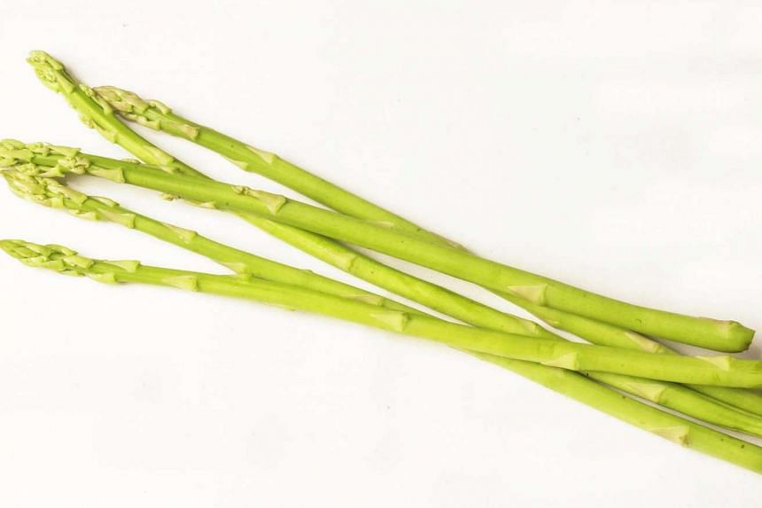 Unlike the usual straight asparagus spears, this year's crop is crooked because changing weather has affected the plant's growth cycles. PHOTO: ST FILE