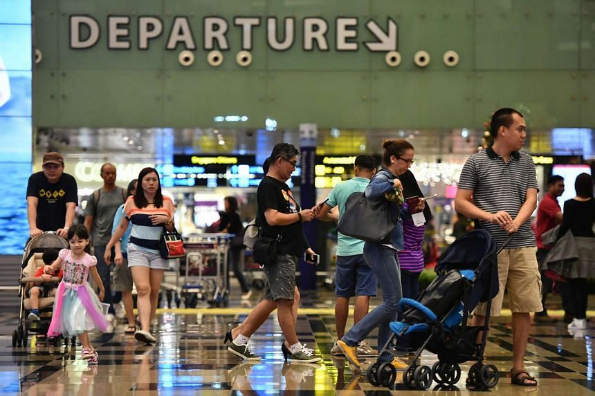Travellers at the departure hall in Changi Airport Terminal 3.