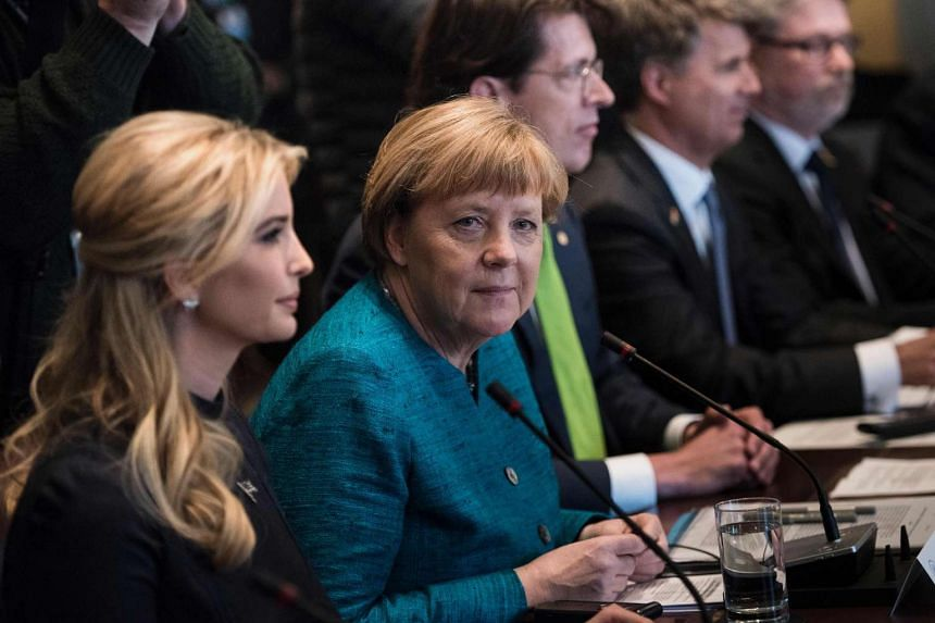 Ivanka Trump (left) and Germany's Chancellor Angela Merkel waiting for a meeting with US President Donald Trump and business leaders in the Cabinet Room of the White House, on March 17, 2017, in Washington, DC.
