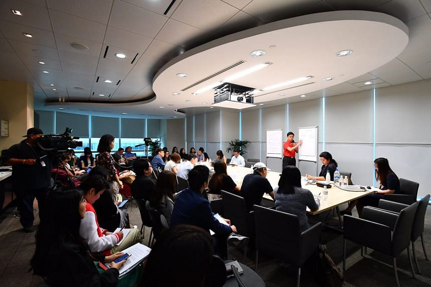 NTUC Secretary-general Chan Chun Sing explaining NTUC's strategy to strengthen its relevance to working people in this time of change, at NTUC Centre on April 25, 2017.
