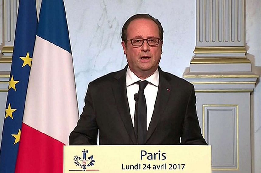 French President Francois Hollande is seen, in a still from a video, speaking from the Elysee Palace on April 24, 2017.