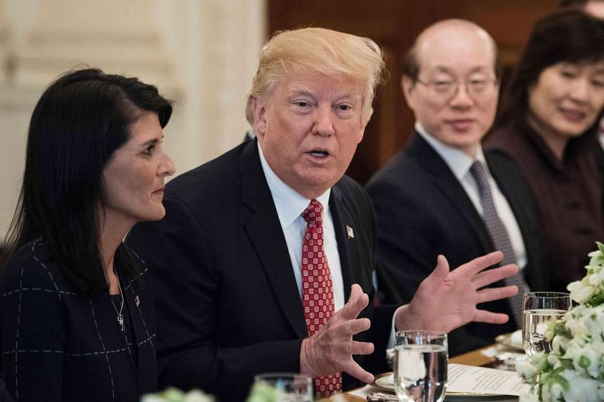US Ambassador to the UN Nikki Haley (left) and China's Ambassador to the UN Liu Jieyi (second from right) listen while US President Donald Trump speaks before a working lunch at  the White House on April 24, 2017.