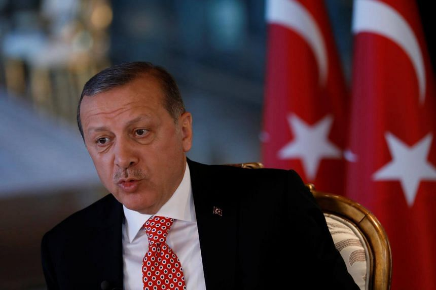 Turkish President Tayyip Erdogan attends an interview with Reuters at the Presidential Palace in Ankara, on April 25, 2017.
