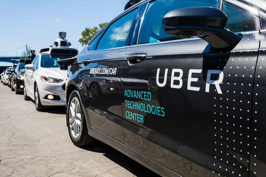 Pilot models of the Uber self-driving car in a 2016 file photo. Uber aims to use flying taxis by 2020.