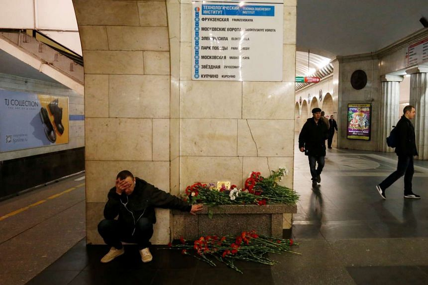 A man reacts next to a memorial for the victims of a blast in St Petersburg metro, April 4, 2017.