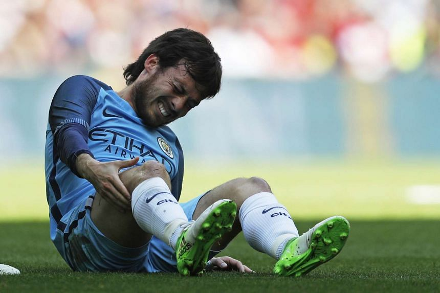 Manchester City's David Silva sustains an injury against Arsenal on April 23, 2017.
