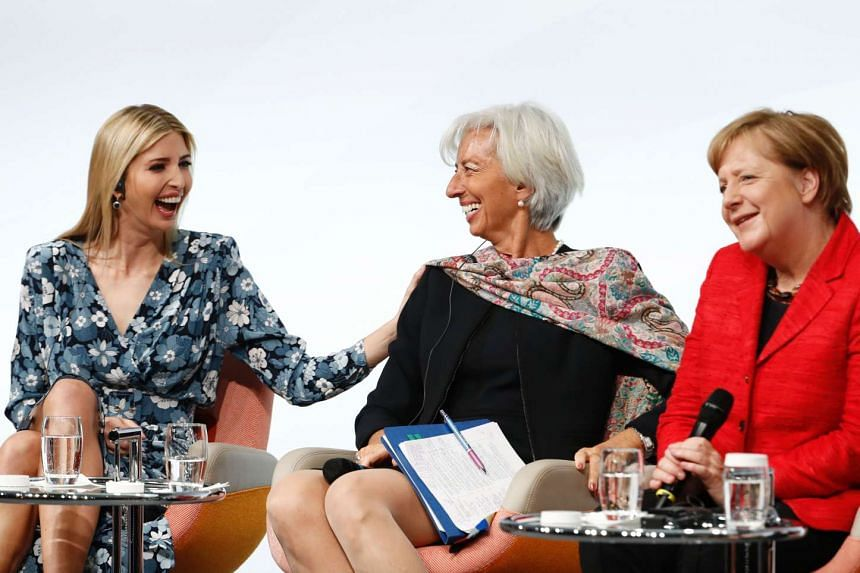 (From left) Ivanka Trump, Christine Lagarde and Angela Merkel share a laugh at the start of the Berlin panel discussion.