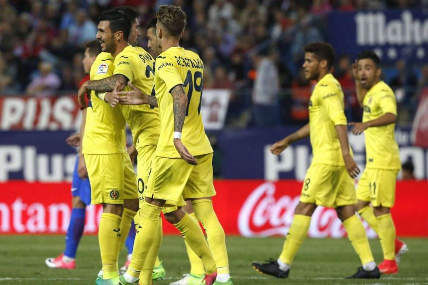 Villarreal players congratulate Roberto Soriano (second left) on his goal.