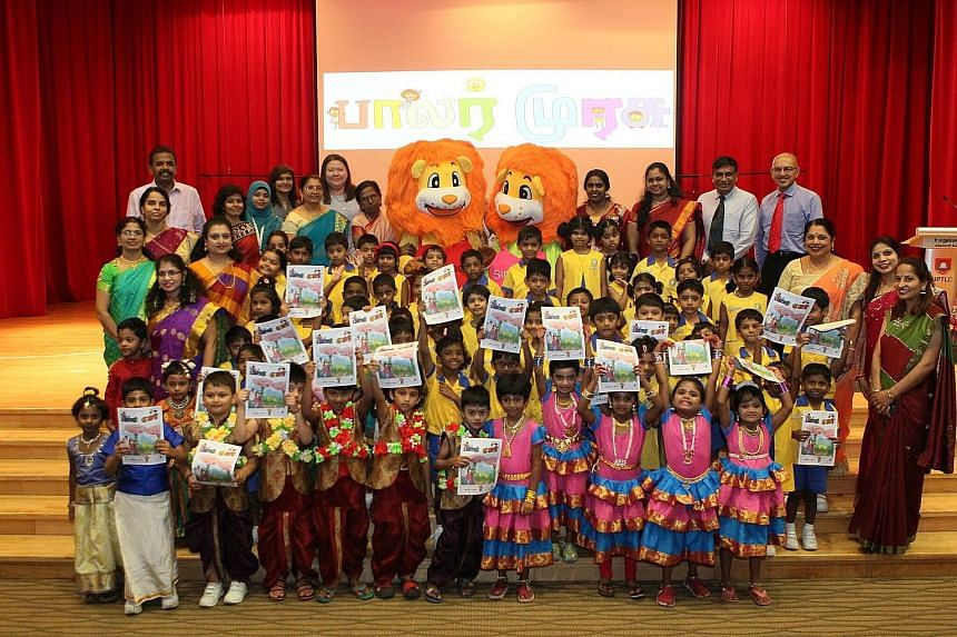 Pupils, teachers and guests at Umar Pulavar Tamil Language Centre for the launch of Balar Murasu, Tamil Murasu's new magazine for preschoolers, yesterday.