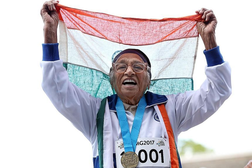 101-year-old Man Kaur celebrating winning the 100m sprint at the World Masters Games. She was the sole competitor in the 100-and-over race.