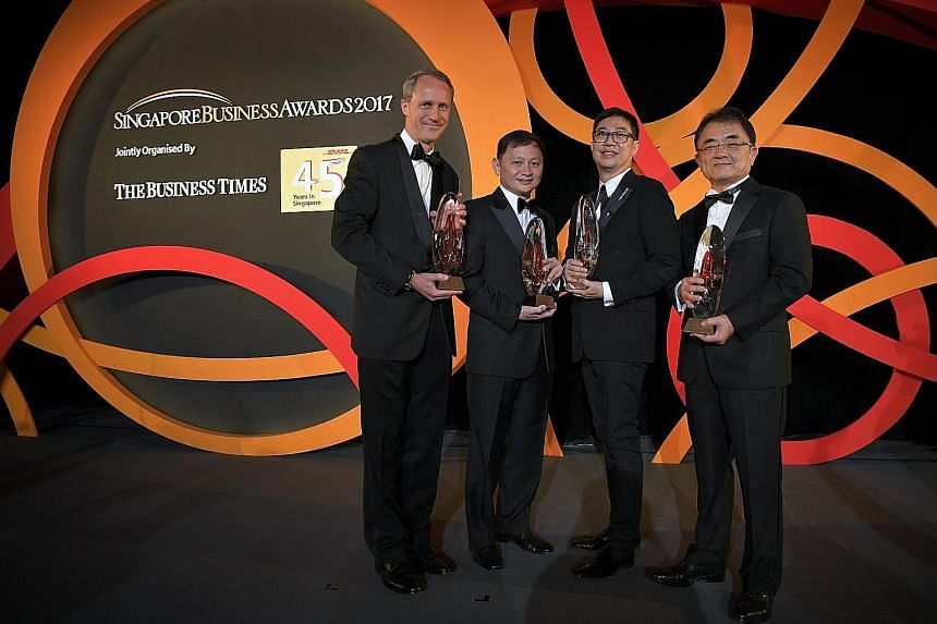 The winners of the Singapore Business Awards 2017 are (from left) Mr Heinrich Jessen, chairman of Jebsen & Jessen (SEA), Businessman of the Year 2016; Mr Goh Choon Phong, chief executive officer, Singapore Airlines Group, Outstanding Chief Executive