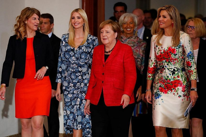 All set for the Women20 Summit in Berlin yesterday were (from left) Association of German Women Entrepreneurs president Stephanie Bschorr, US President Donald Trump's daughter Ivanka, German Chancellor Angela Merkel, International Monetary Fund manag
