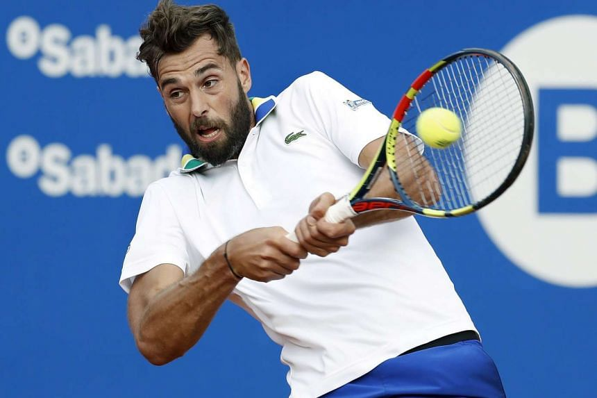 French Benoit Paire returning the ball to Spanish Marcel Granollers during the second round of the 65 edition of the Conde Godo Trophy, held in Barcelona, Spain, on April 25, 2017.