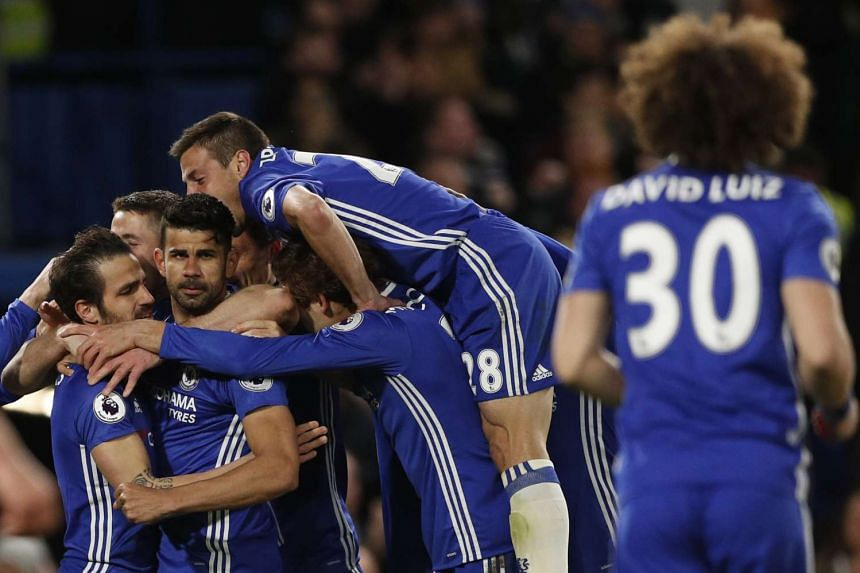 Chelsea's Diego Costa celebrates scoring their third goal with his teammates.