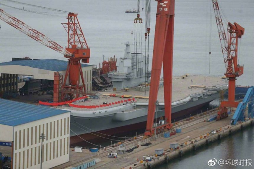 China's first domestically built carrier, known as Type 001A, at its berth in Dalian city in Liaoning province.