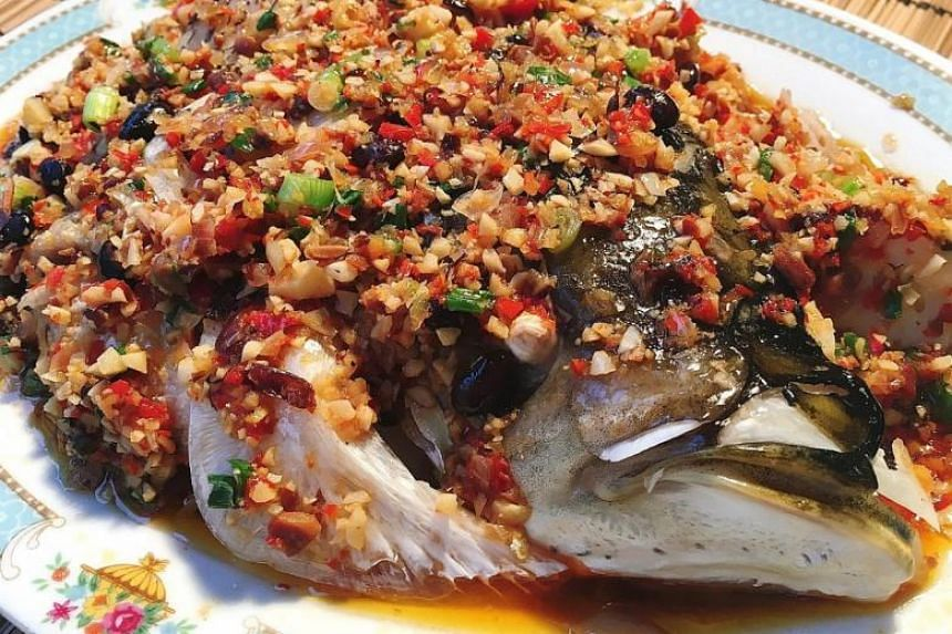 Steamed song fish head with black bean sauce.