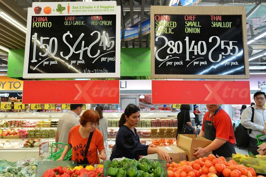 File photo of shoppers at the vegetable section in NTUC FairPrice Xtra at Serangoon NEX mall.