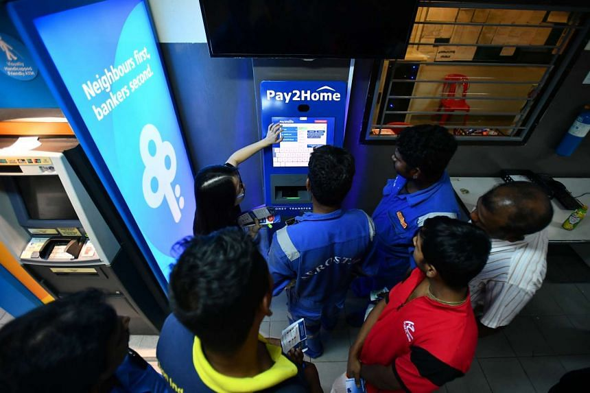Migrant workers queueing up to use the new Pay2Home Money Transfer Machine at Averic Woodlands Dormitory on April 26, 2017.