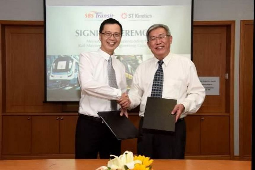 SBS Transit's Chief Executive Officer Gan Juay Kiat (right) with ST Kinetics' President, Dr Lee Shiang Long, after signing the MOU.
