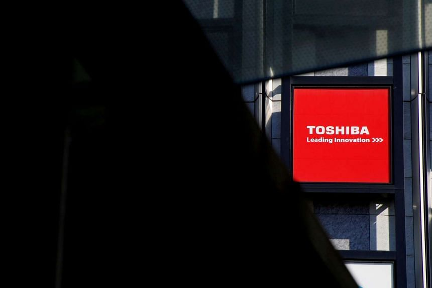 A logo of Toshiba Corp is seen outside an electronics retail store in Tokyo.