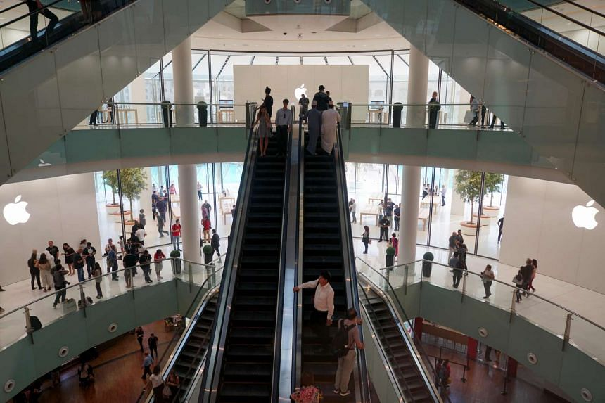The new Apple Store at Dubai Mall takes up two levels and overlooks the iconic Burj Khalifa skyscraper.