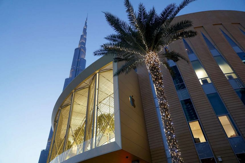 The outer facade of the new Apple Store at Dubai Mall. It takes up two levels and overlooks the iconic Burj Khalifa skyscraper.